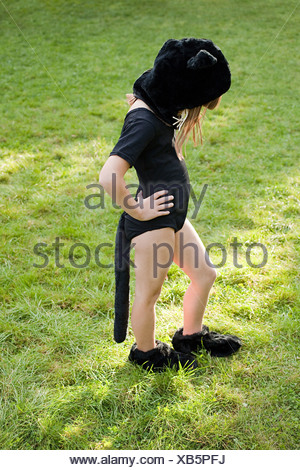 Girl dressed as cat - Stock Photo