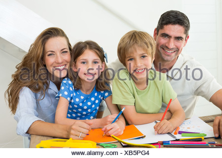 Parents with children drawing at home - Stock Photo