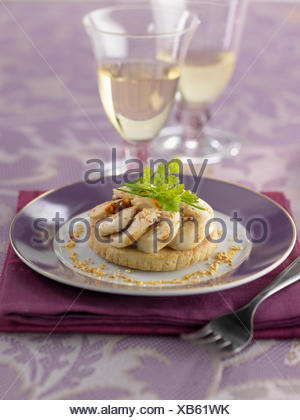 Shortbread topped with white sausage ,mustard and sesame sauce - Stock Photo