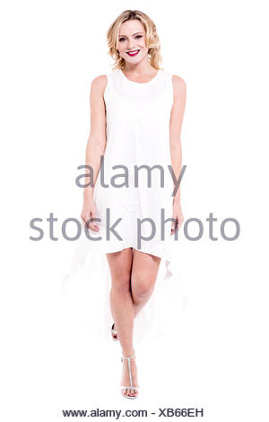 Attractive woman wearing white dress