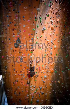 Sandy,Utah,USA,Boy (12-13) on climbing wall - Stock Photo