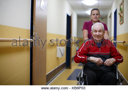 Senior citizen, 87 years, wheelchair, nurse for the elderly, nursing home - Stock Photo