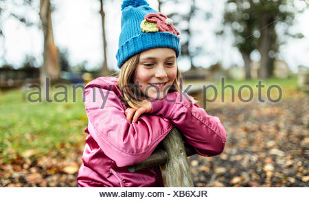 Portrait of happy girl on a playground in autumn - Stock Photo