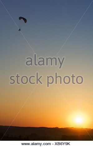 Paraglider at sunset - Stock Photo