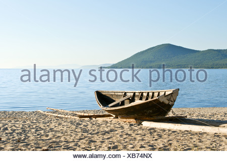 Fishermen boat in the coast - Stock Photo