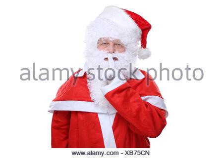 Weihnachtsmann Nikolaus hat Weihnachten Geheimnis Freisteller freigestellt vor einem weissen Hintergrund - Stock Photo