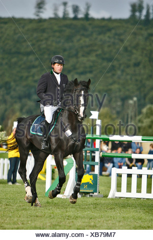 Show jumper Lars Nieberg, double Olympic champion and Emilio, Niederweimar, Germany - Stock Photo