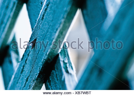 A Nail Sticking Out Of A Wooden Fence Board - Stock Photo