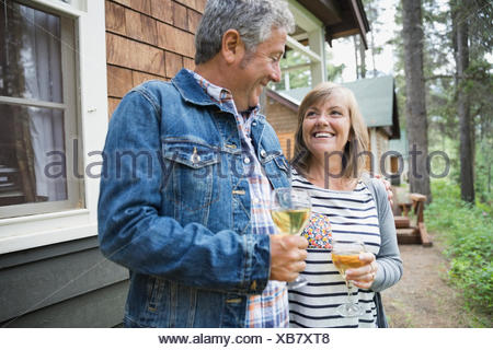 Happy couple drinking wine outdoors - Stock Photo