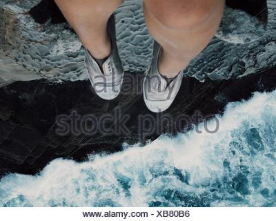 Woman Sitting On Cliff - Stock Photo