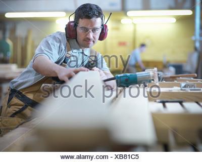 Woodworker in workshop - Stock Photo