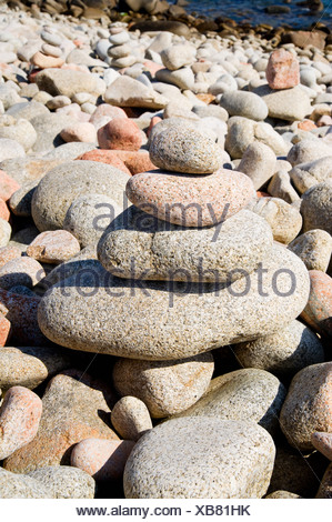 Stack of pebbles on beach - Stock Photo