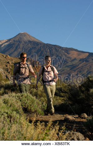 Hikers in front of Mount Teide, Teide National Park, Tenerife, Canary Islands, Spain, Europe - Stock Photo