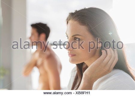 Close up of woman with hand in hair - Stock Photo