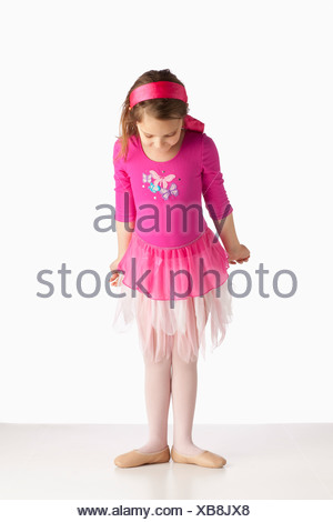 A Girl Wearing Ballet Shoes In A Ballet Pose - Stock Photo