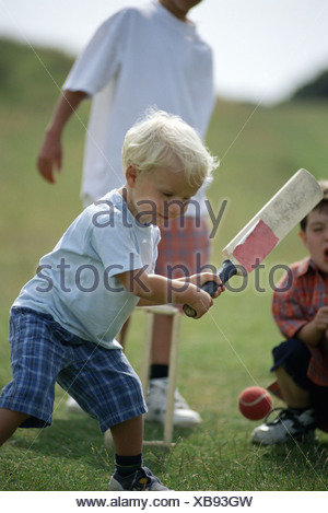 Boys playing cricket - Stock Photo