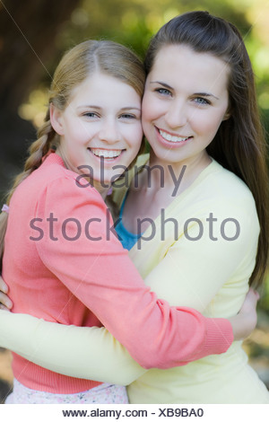 Two sisters outdoors - Stock Photo