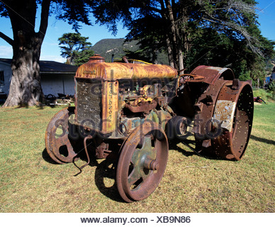Old tractor, rusty, North Island, New Zealand - Stock Photo