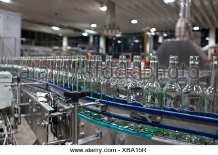 Empty beer bottles after cleaning, on a conveyor belt, Binding brewery, Frankfurt, Hesse, Germany, Europe - Stock Photo