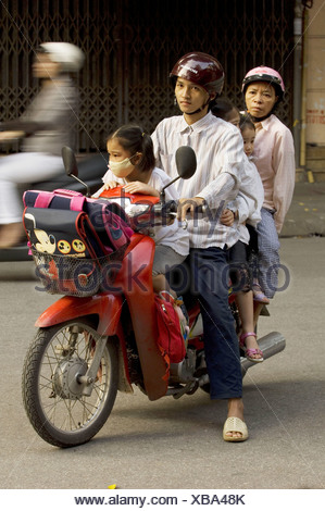 family of 5 persons on a motor bike, Vietnam, Hanoi - Stock Photo