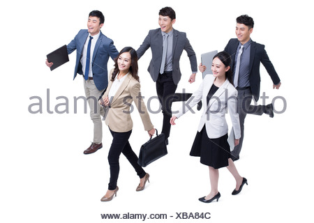 Business people walking forward confidently - Stock Photo