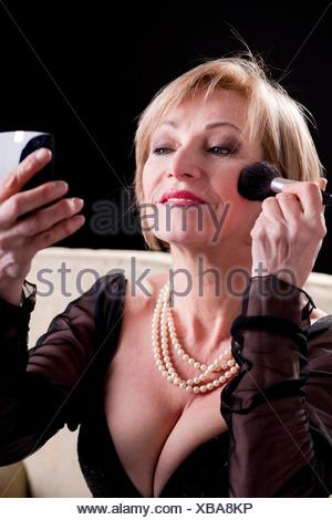 Elegant Woman in evening gown Making Up - Stock Photo