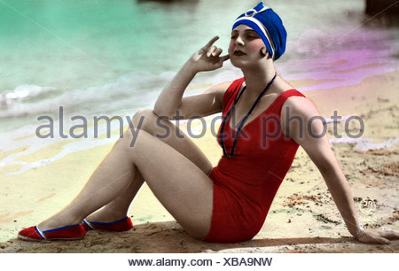 bathing, swimsuit, young woman, wearing swimsuit, sitting on the beach, 1920s, coloured postcard, red, bathing suit, fashion, sandy beach, bathing cap, ,