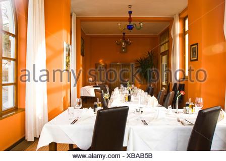 Set tables, Lido Lounge in Klagenfurt, Carinthia, Austria - Stock Photo
