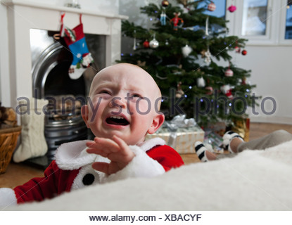 A baby crying at Christmas - Stock Photo