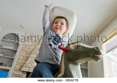 Little boy pretending to be a cowboy - Stock Photo