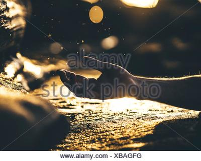 Human Hand In Gesture, Reflecting Surface - Stock Photo