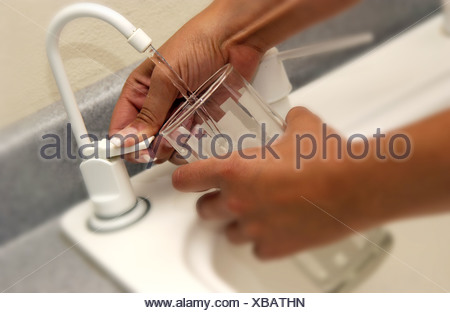 Woman getting a glass of water - Stock Photo