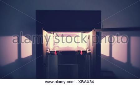 Three Dimensional Printer In Room - Stock Photo