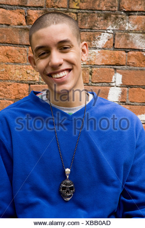 Mixed Race smiling Teenager - Stock Photo