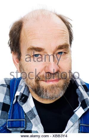 Studio portrait of senior man - Stock Photo
