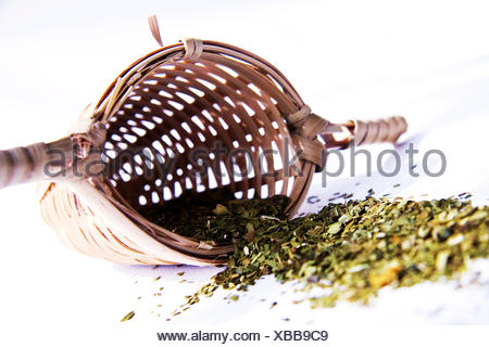 Green tea with bamboo tea strainer on white background - Stock Photo