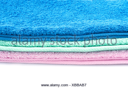 Color towels isolated on white background - Stock Photo