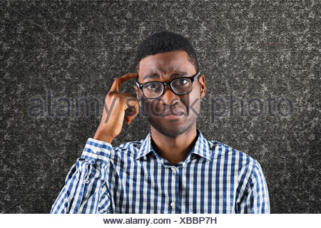 Composite image of confused casual businessman - Stock Photo