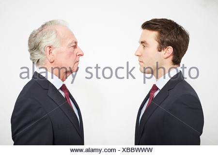 Businessmen facing each other - Stock Photo