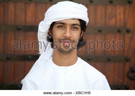 Middle Eastern man wearing headdress, portrait - Stock Photo