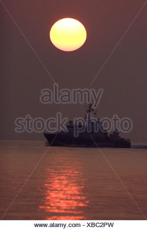 coast guard ship at dawn, Germany, Mecklenburg-Western Pomerania - Stock Photo
