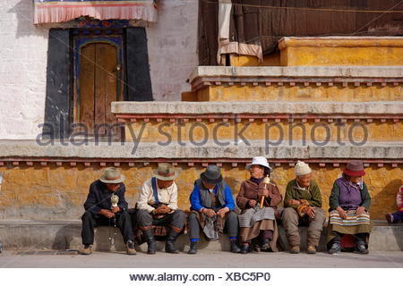 geography / travel, Tibet, Pilgrims sitting in front of the Jokhang temple, Lhassa, Additional-Rights-Clearance-Info-Not-Available - Stock Photo