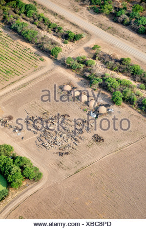 Aerial view from a Cessna aircraft, wood and kilns for the production of charcoal, also contributing to forest degradation - Stock Photo