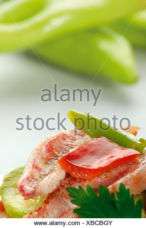 Vegetables with striped red mullet, Tumbet de Salmonete - Stock Photo