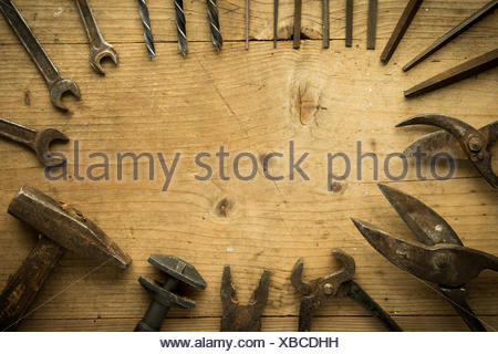 old retro used tools on wooden table - Stock Photo