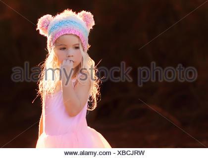 Little girl (4-5) wearing hat with bear ears - Stock Photo
