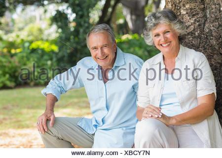 Happy mature couple in park - Stock Photo