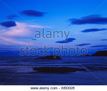 Lenticular clouds moon dusk Eagle Bay northeast Right Hand Point Togiak National Wildlife Refuge Bristol Bay Bering Sea Alaska. - Stock Photo