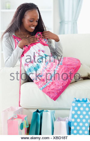 Close up of woman with her shopping on sofa - Stock Photo