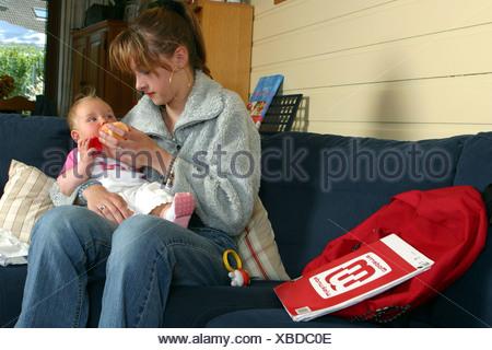 Teenager babysitting - Stock Photo